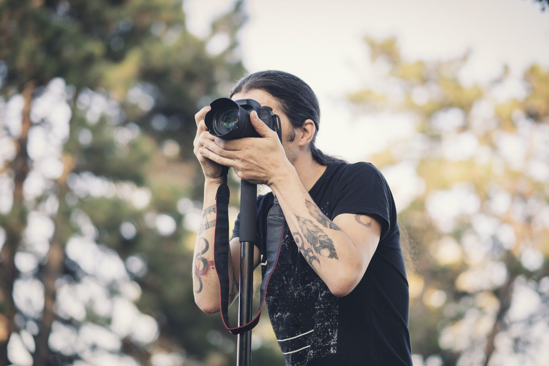 Man using a camera monopod