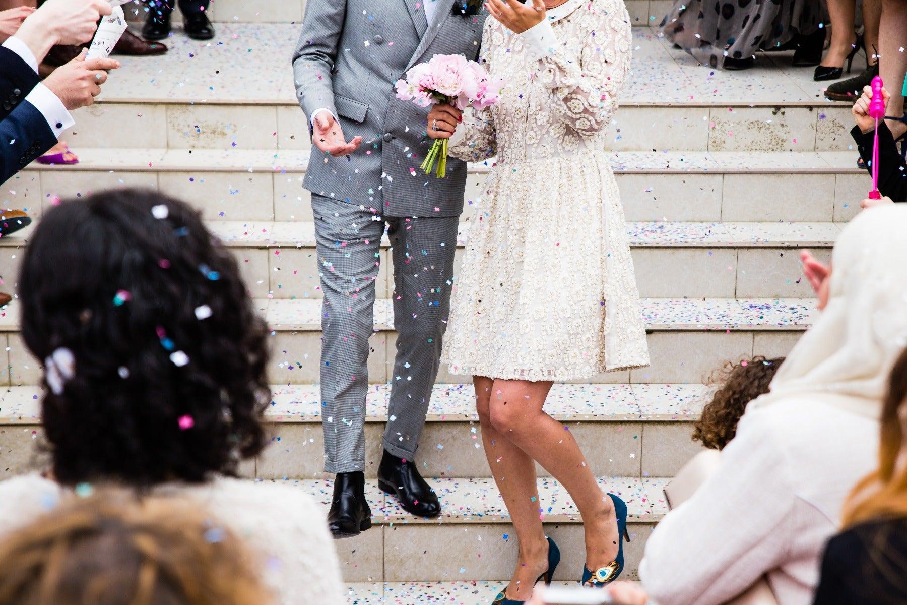Wedding throwing confetti