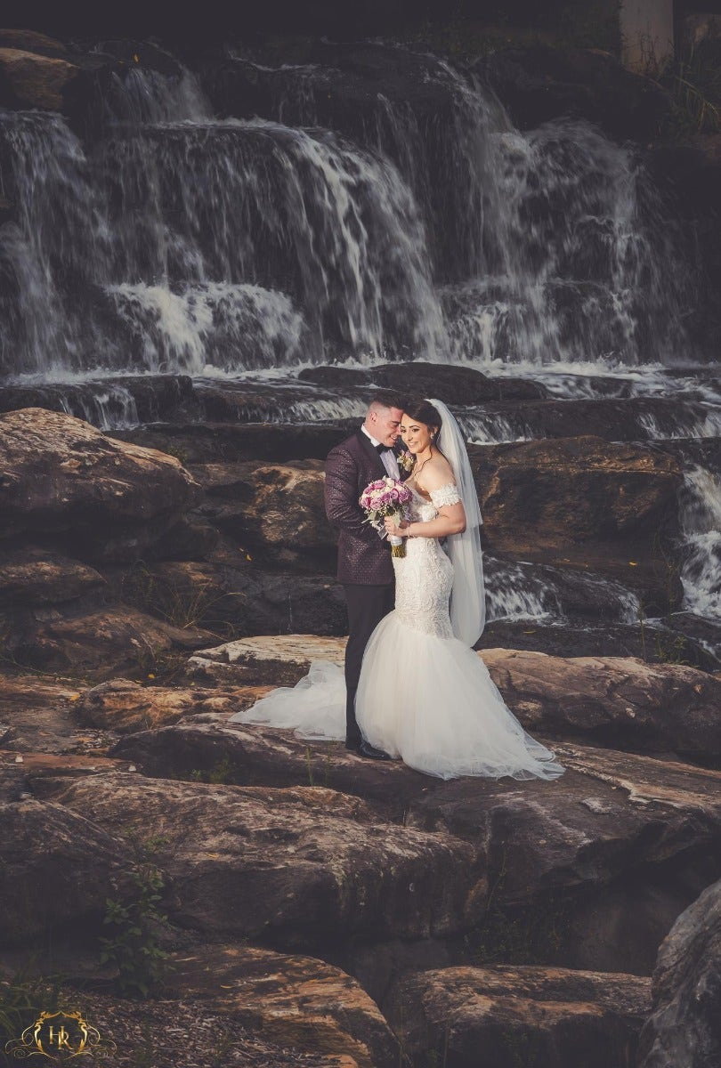 Wedding environmental portrait in front of waterfall