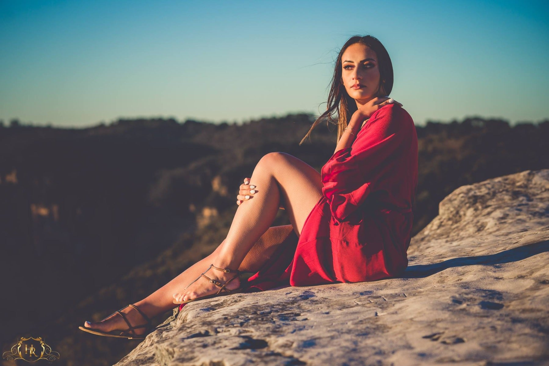 Environmental portrait in nature with red dress