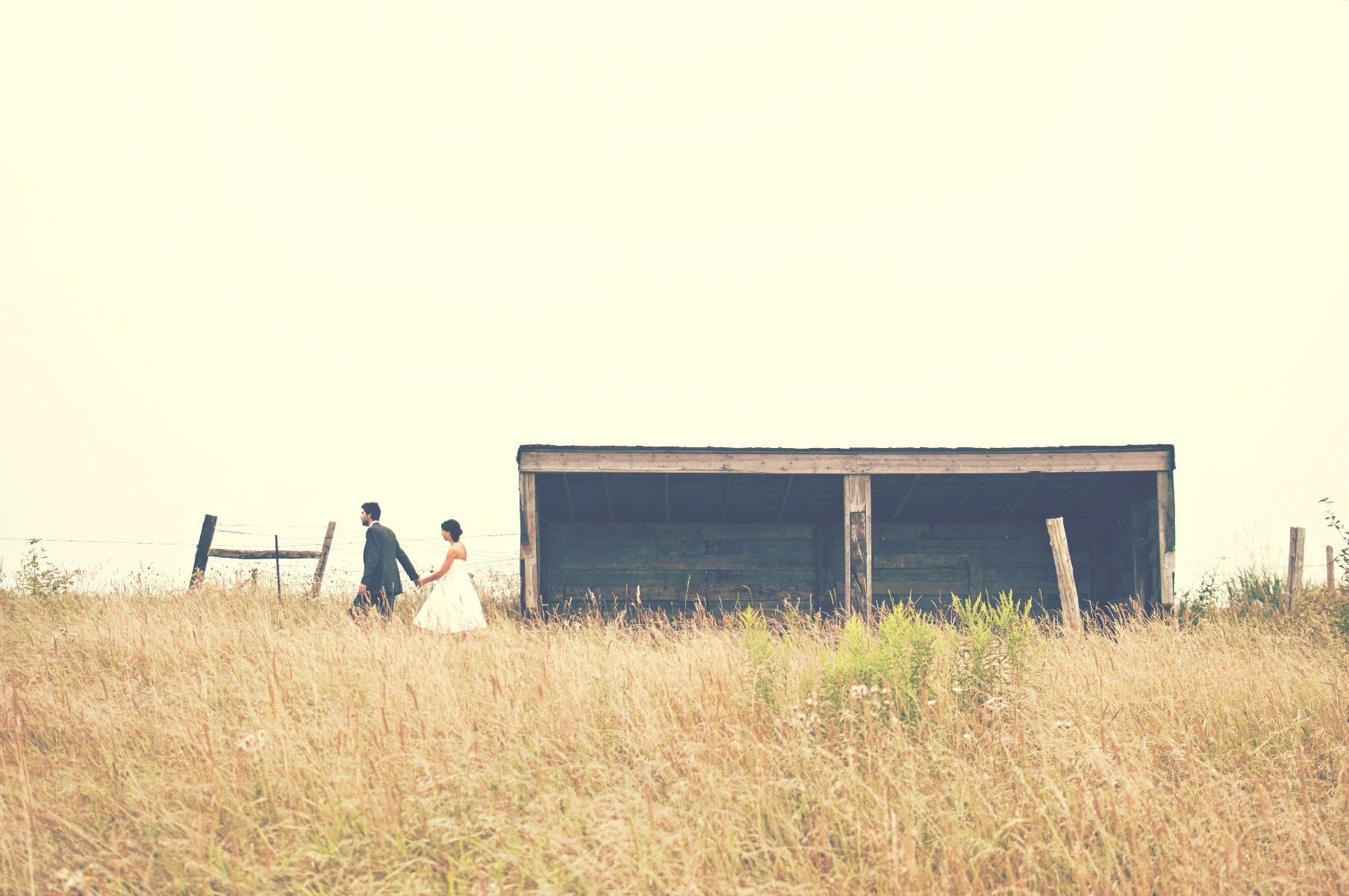 Bride & Groom in a field with shack