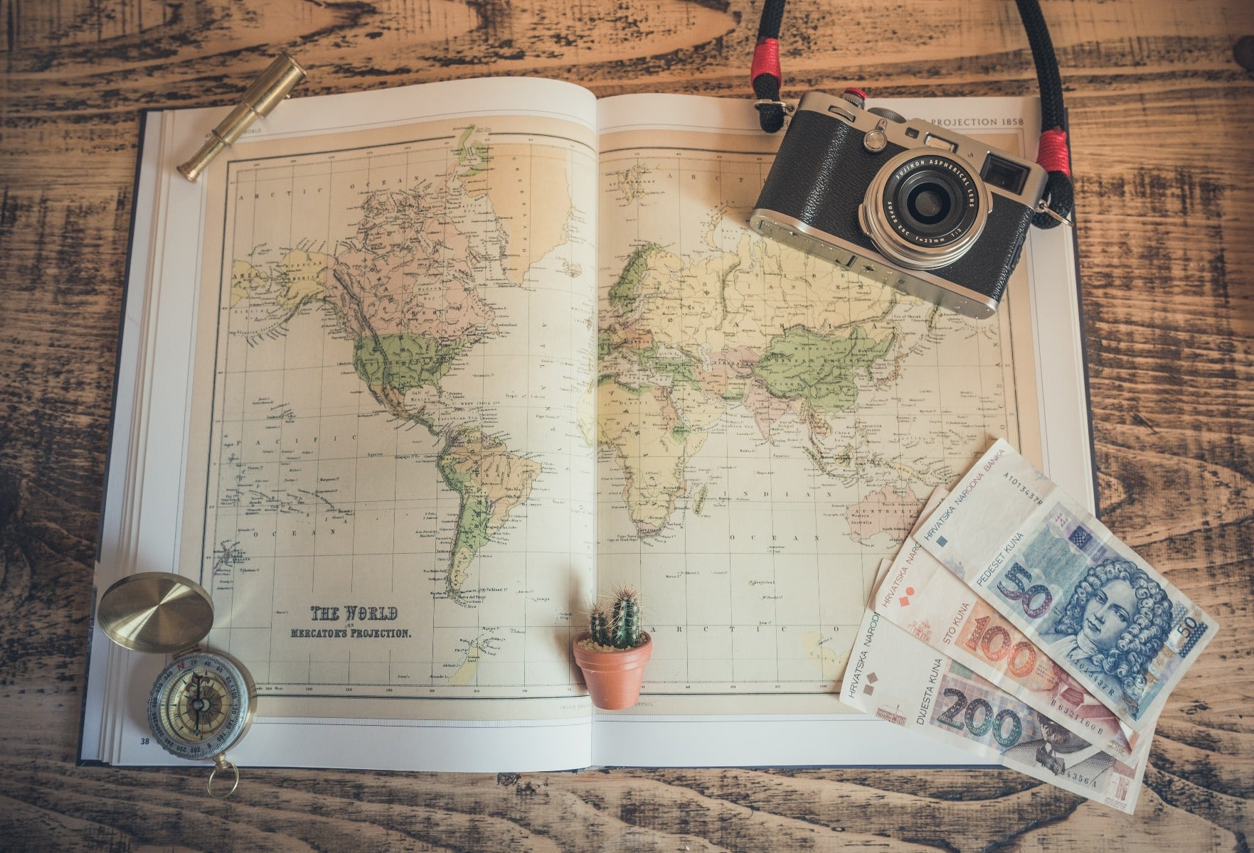 Map with camera and travel accessories