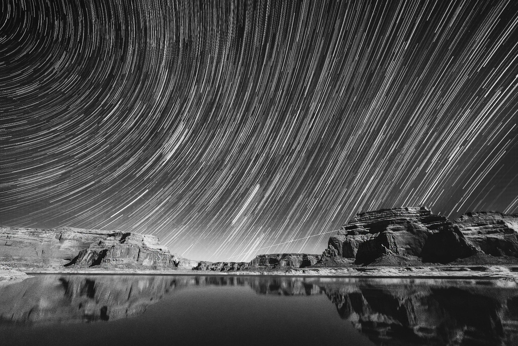 Star trails over body of water