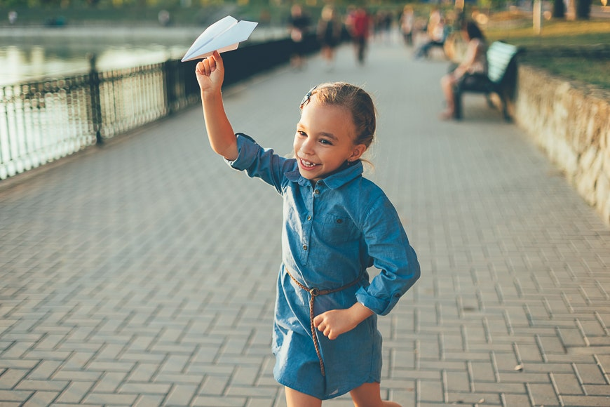 Little girl with paper airplane