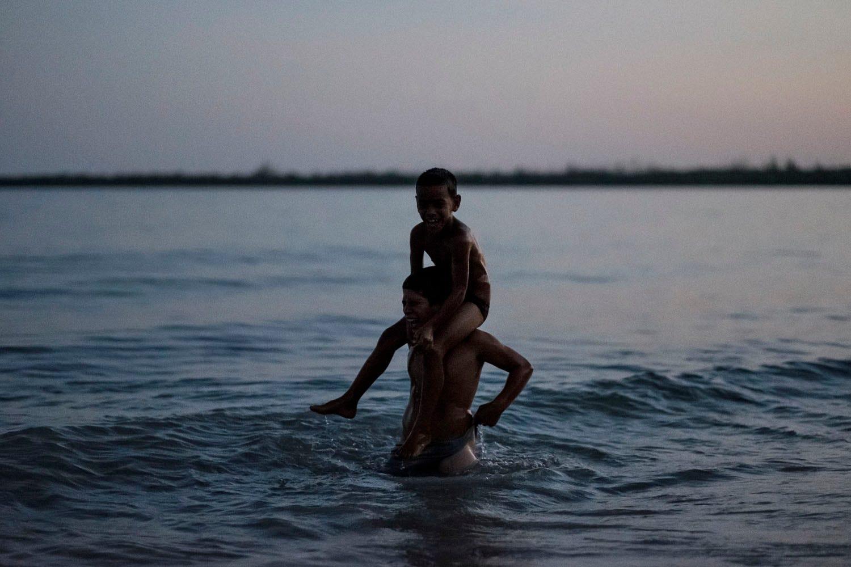 Boys laughing in ocean