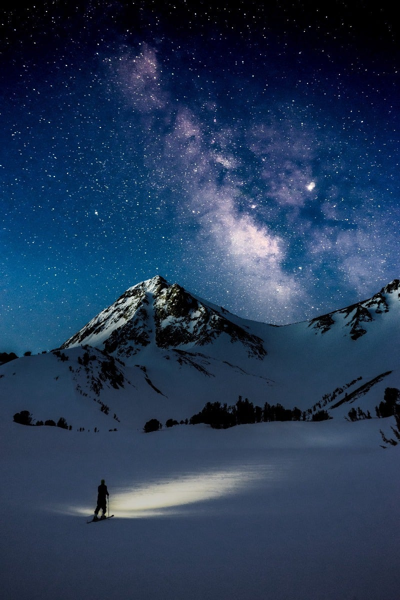 Galaxy over snowy mountains