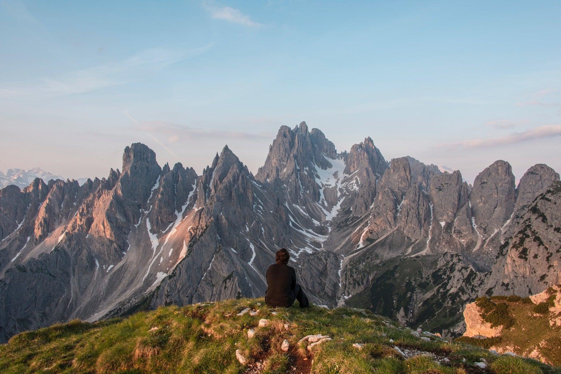 Man looking at mountain range